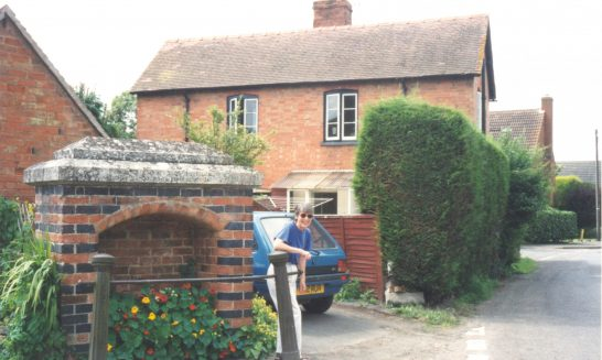 Helen Dornan at the water stand pipe /Fountain near Tadpole Cottage