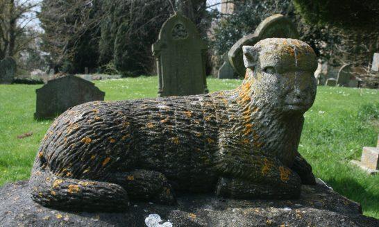 Churchyard: Carved sheep on gravestone