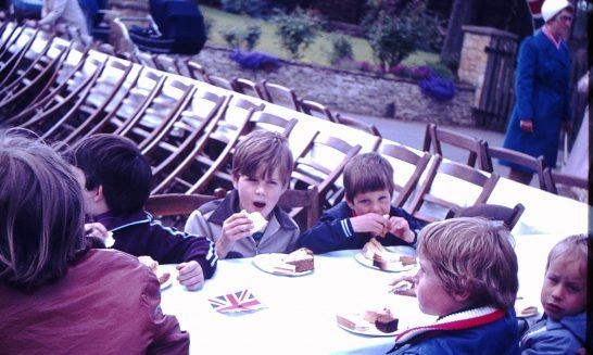 Children Enjoying Food at a Street Party