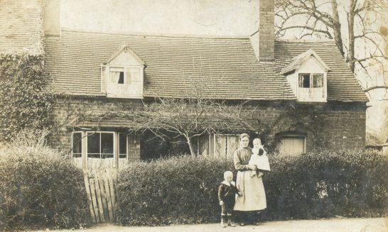 Kinchin Family outside Vine Cottage